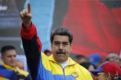 Venezuela's President Nicolas Maduro leads a rally condemning U.S. economic sanctions imposed on Venezuela, in Caracas, Aug. 10, 2019.