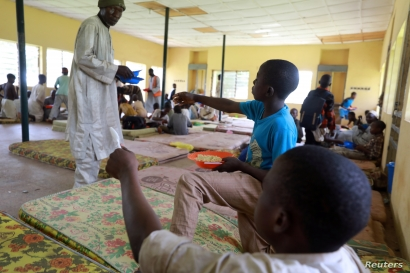 Children rescued from captivity by police are fed by officials at the Hajj transit camp in Kaduna, Nigeria September 28, 2019…