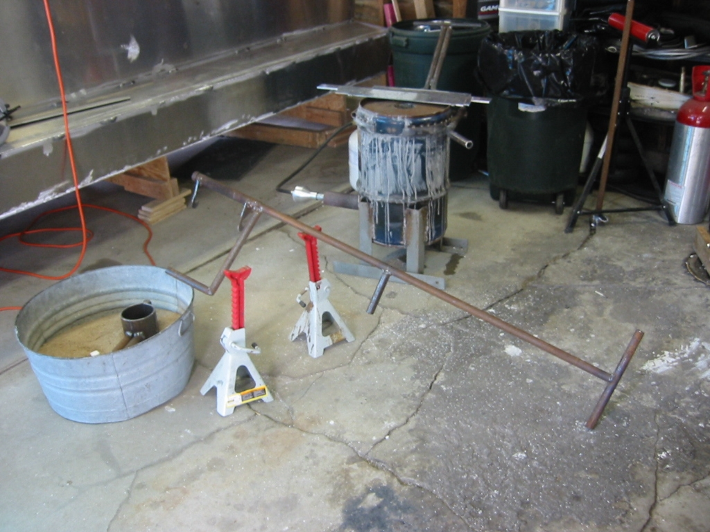 (8) Jack stands make a nice rest of the crucible so that it is not set on the concrete.
