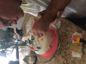 az-trevor-decorating-sakaris-birthday-cake