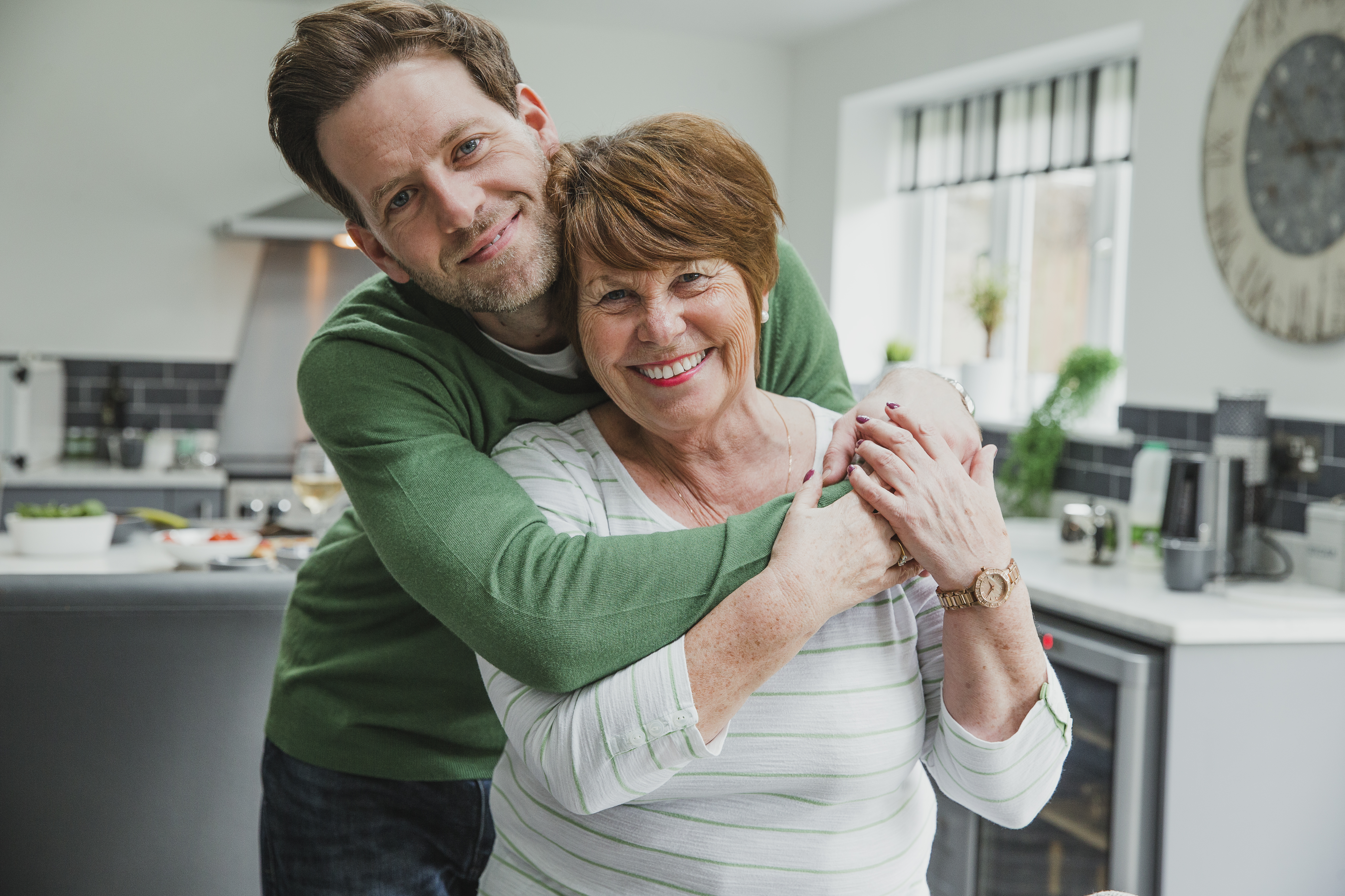A happy mother who has helped her son cope with the social repercussions of drug addiction.