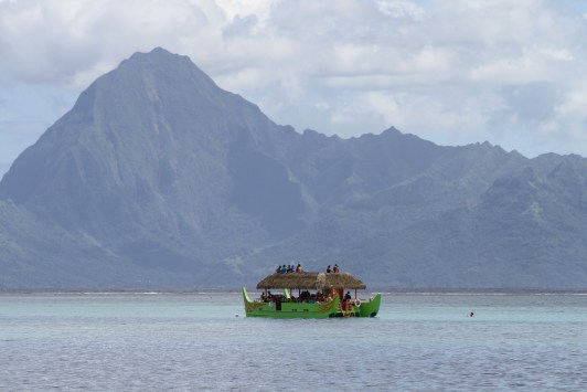 locals enjoying a Sunday outing, with the island of Moorea in the background