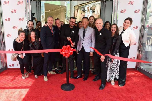 NEW YORK, NY - MAY 20: John Legend, H&M president Daniel Kulle and the H&M team cut the ribbon for the H&M Herald Center Flagship opening with John Legend on May 20, 2015 in New York City. (Photo by Larry Busacca/Getty Images for H&M)