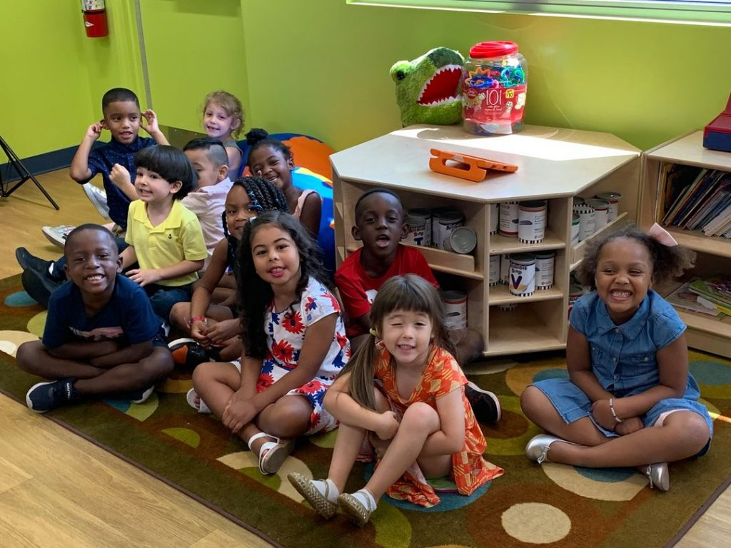 The graduating class of 2020 sits together in the CHILD Center classroom