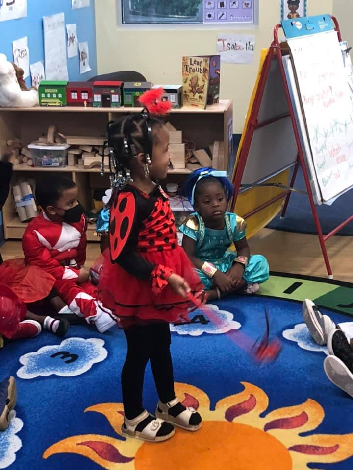 A CHILD Center student wearing a ladybug costume