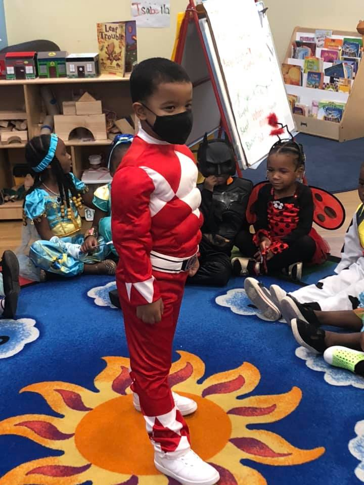 A CHILD Center student wearing a superhero costume
