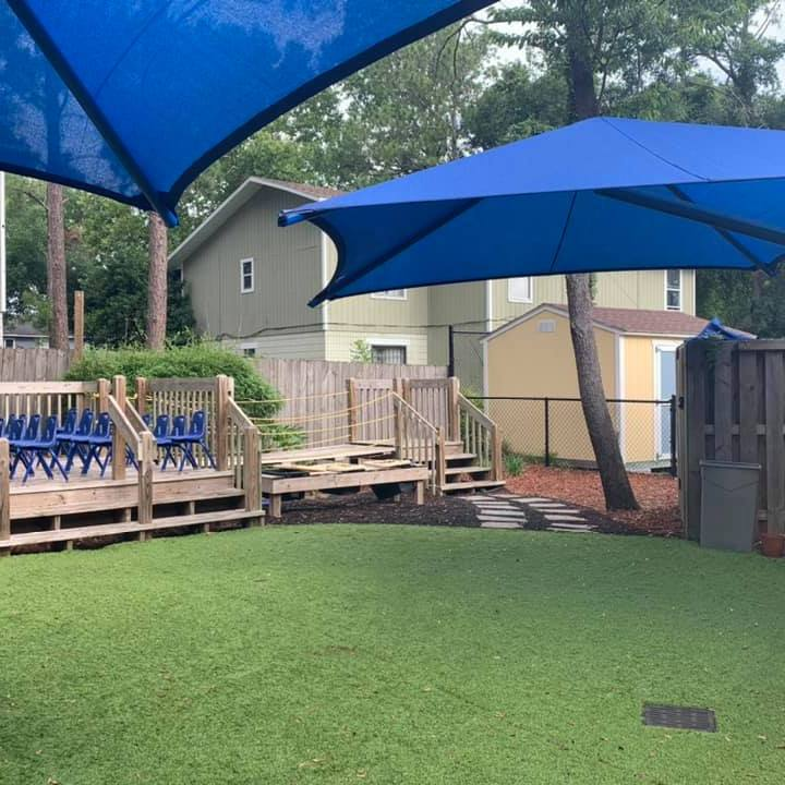 Chairs are set up on the back deck of the CHILD Center for the Summer 2021 graduation ceremony
