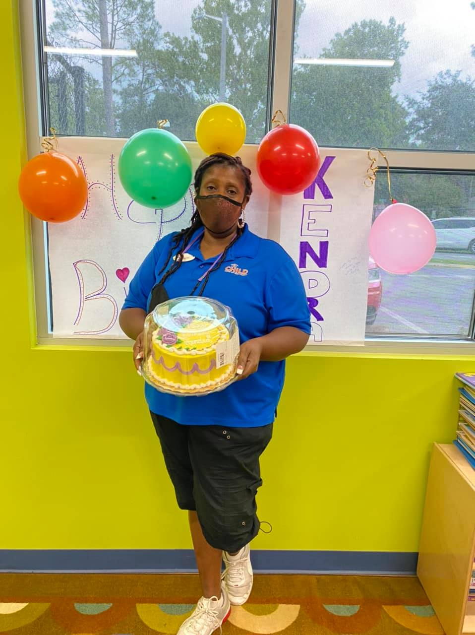 Mrs. Kendra holds a cake for her birthday, which we celebrated during Day #2 of the Summer 2021 teacher training