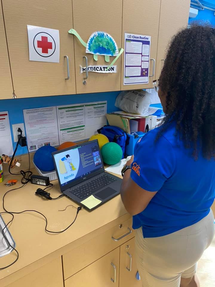 A CHILD Center staff member reviews training materials during the Summer 2021 teacher training
