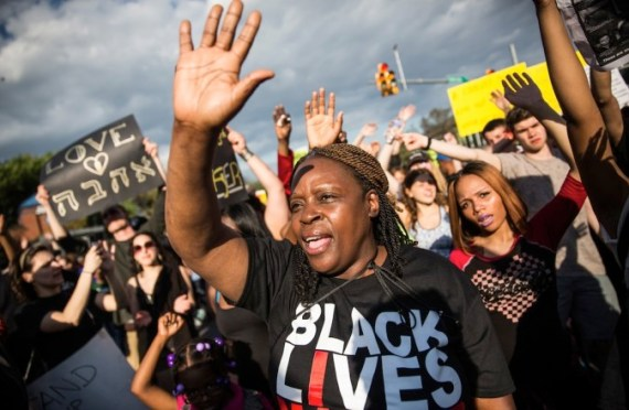 BALTIMORE, MD - MAY 02: Protesters march from City hall to the Sandtown neighborhood May 2, 2015 in Baltimore, Maryland. Freddie Gray, 25, was arrested for possessing a switch blade knife April 12 outside the Gilmor Houses housing project on Baltimore's west side. According to Gray's attorney, Gray died a week later in the hospital from a severe spinal cord injury he received while in police custody. State attorney Marilyn Mosby of Maryland announced that charges would be brought against the six police officers who arrested Gray. (Photo by Andrew Burton/Getty Images)