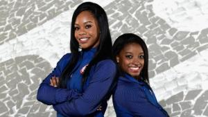 Gabby Douglas and Simone Biles. Photo by Harriet How/Getty Images.