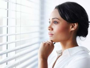 black-woman-deep-in-thought-163640813-cropped