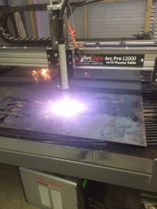 Plasma cutting the Swamp Head logo out of stainless steel.