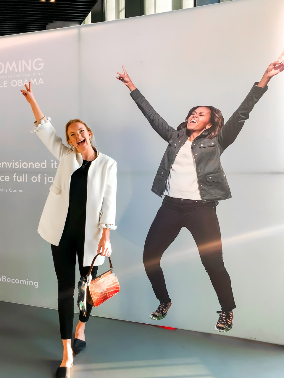 Posing next to an excited Michelle Obama on a poster at her Copenhagen stop on the Becoming Book Tour