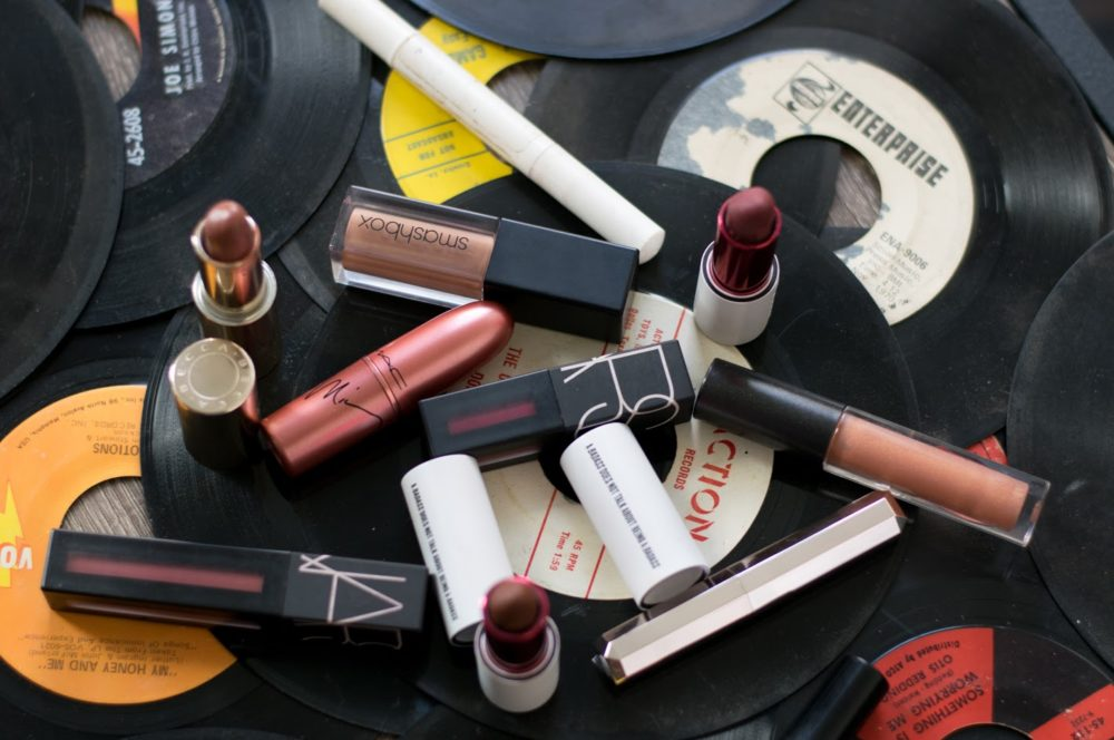 matte lipsticks displayed on vinyl records