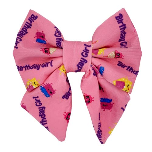 """Pink background for the birthday girl dog sailor bow tie with little presents and """"Birthday Girl"""" written across"""