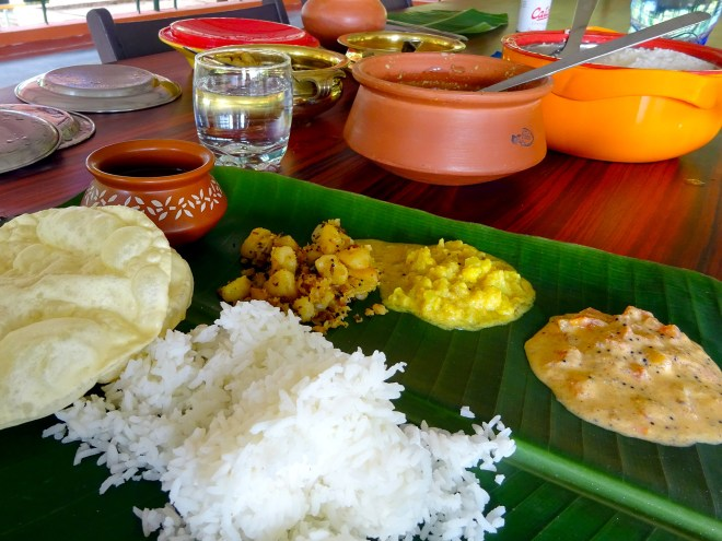Traditional Kerala lunch served on a banana leaf