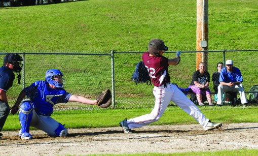 Landen Sommerkorn (22) slaps a ball down the third base line.