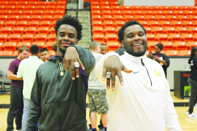 Brothers Darius Hopkins and Winland Ogden show off their new piece of jewelry after the ring ceremony Friday afternoon at Scrapper Arena. This was Ogden's last year as a Scrapper but Hopkins will return to help the Scrappers quest to make it back to back title seasons.