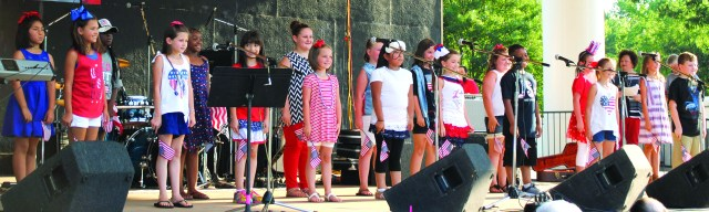 "Nashville Primary School students directed by Stacia Petty sing ""Battle Cry of Freedom"" Saturday during Stand Up for America. The patriotic celebration attracted hundreds to the Nashville City Park."
