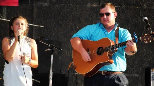 Maci Bishop sings as Robert Womack accompanies her on the guitar.