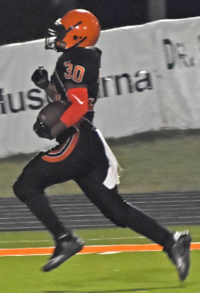 Jacobe Jefferson runs for 1 of his 3 touchdowns last Thursday night against Bauxite.