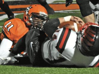 Davion Holmes (11) tackles Pea Ridge quarterback Jakota Sainsbury.