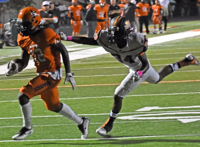 Darius Hopkins (12) eludes the Leopard defender as he scampers to the endzone for 1 of his 5 touchdowns Friday night at home against Malvern.