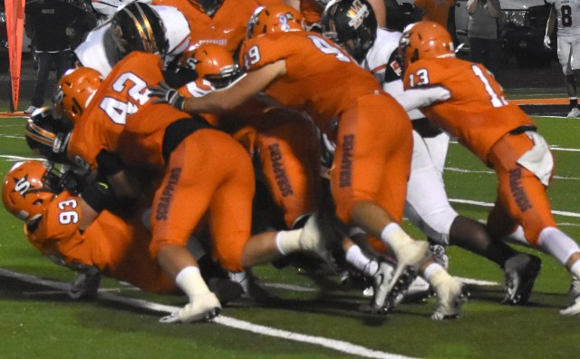 Nashville defenders con- verge on the Malvern ballcarrier Friday night during the Scrappers' 54-21 victory over the Leopards. Among the tacklers are Jesse Davis (93), Michael Bevill (42), Garrett Gordon (49) and Zach Jamison (13) The Scrapper defense limited Malvern to 1 TD in the  rst half and 2 in the second half.