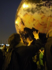 Alex and giant globe during climate justice march