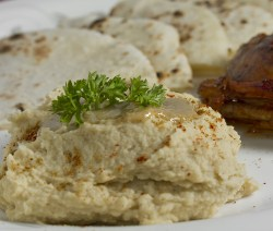 Hummus served with Pita Bread and Chicken Winglets.