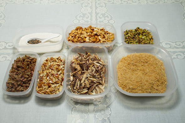 Sugar, Cardamom, Fried  dry fruits (Cashews, Pistachios,  Resins and Almonds), vertically cut dry dates, and thin sewai.