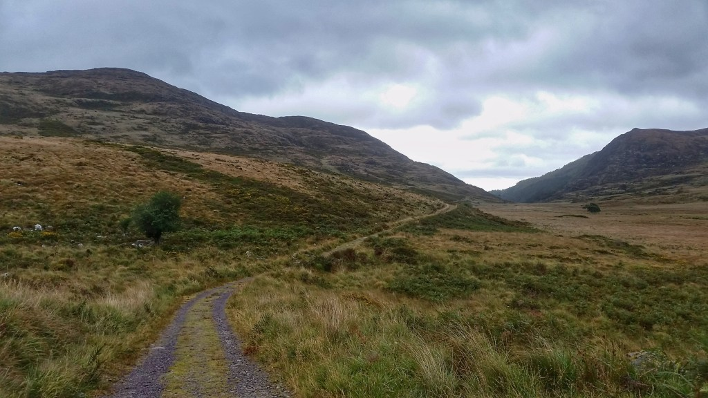 Looking back on the pass through Killarney National Park. Torc Mountain guards the path on the left, while Mangerton lies to the right. There's a lake near the top of Mangerton known as the Devil's Punch Bowl. Photo: Sara Weaver, Sept. 2017.