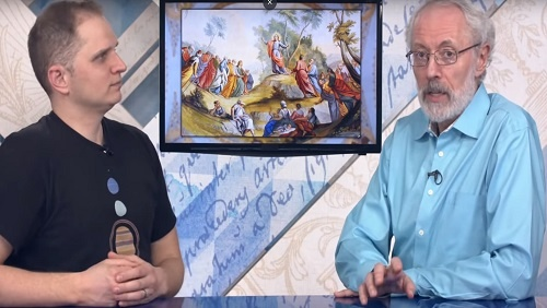 "Curtis and Jonathan sit at the anchor desk, an painting of ""The Sermon on the Mount"" on a screen between them."