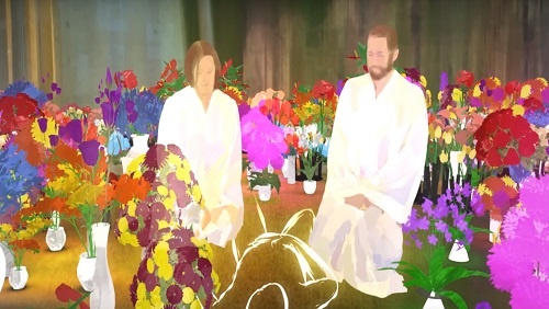 Two angels dressed in glowing white robes sit on either side of a prone human figure. They are surrounded by vibrant flower arrangements.