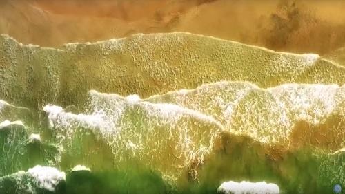 Meditation image, waves washing up on a sandy beach.