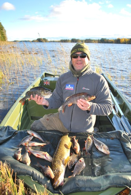 pike perch lake fishing northern sweden holiday