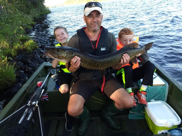 105cm pike caught by a 9 year old boy with sweden fishing and birding - umea, vasterbotten boat fishing trip..