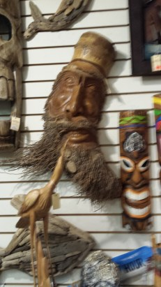 Clever carving from the stump of a palm tree, using the roots of the tree for the character's beard!