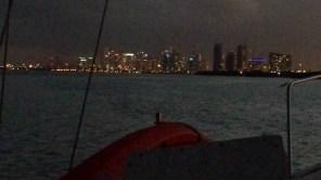 Part of Miami skyline at night.