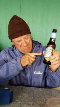 """Goofing around with an """"Angry Orchard"""" beer at the Provision Company."""
