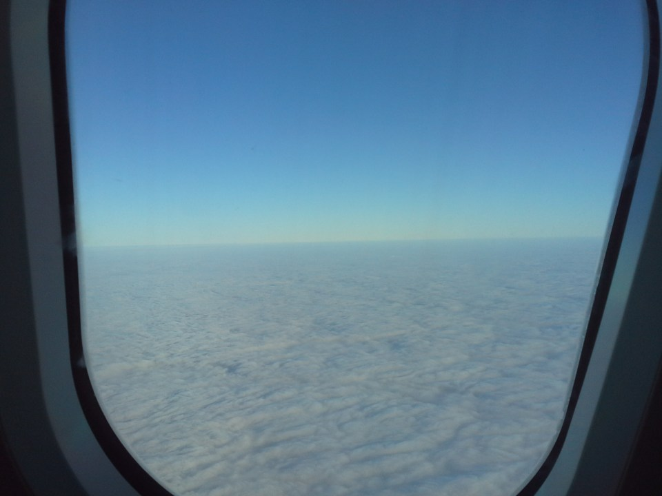 sky through the window of a plane