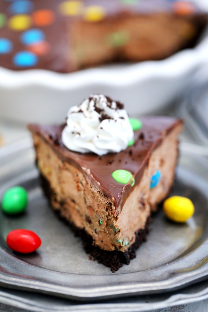 No-Bake M&M's Pie with Oreo crust is creamy, nutty, and chocolaty! It is so colorful and festive that it makes for a great dessert for kids and the kids-at-heart! #halloween #nobake #pie #chocolatepie #sweetandsavorymeals