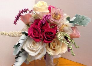 Roses and 'Blushing Bride ' protea are the focal point of this bouquet