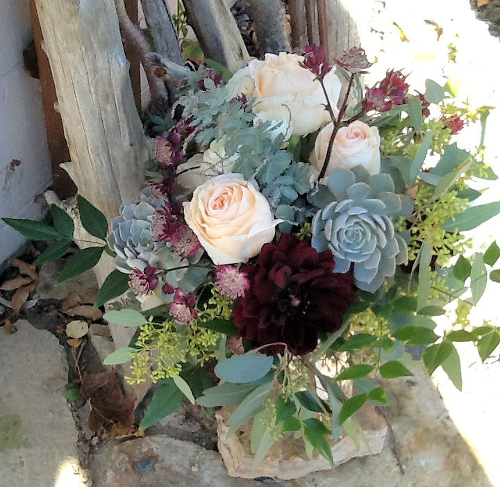 Roses, astrantia and echeveria for a rustic bouquet