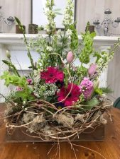 Bells of Ireland and white larkspur go well with bright pink Gerber daisies and pale pink tulips
