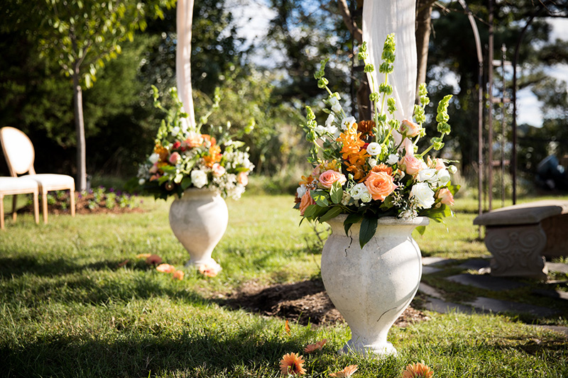 Wedding Urns Filled with Peach Florals and greenery designed by Sweetbay Flowers | Eastern Shore Florist|