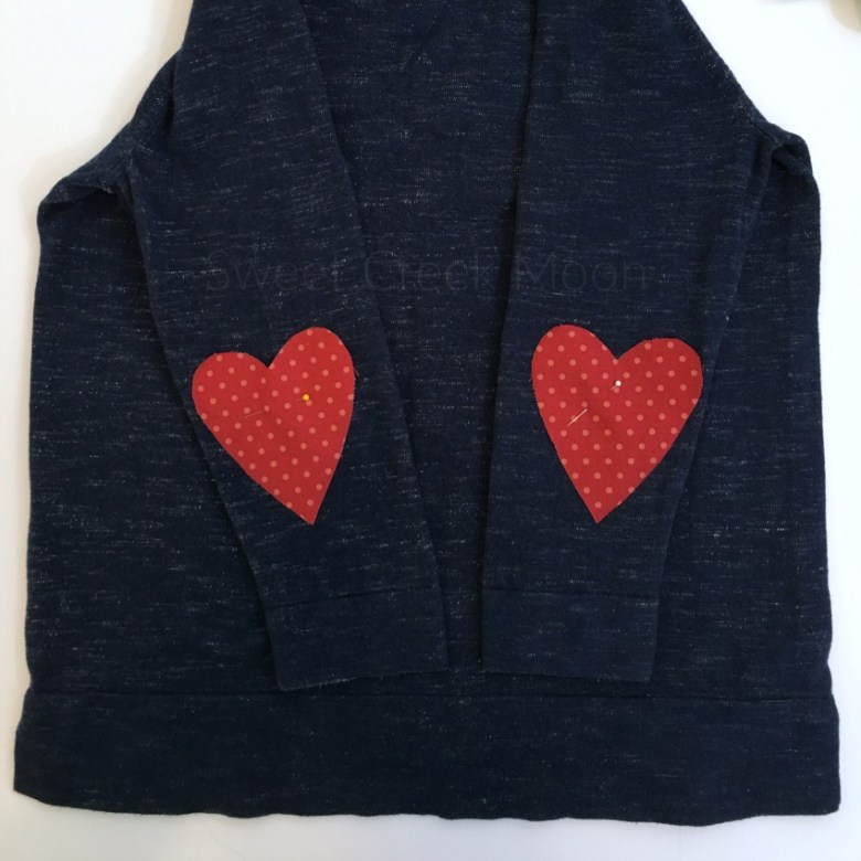 heart elbow patch top pinned before ironing