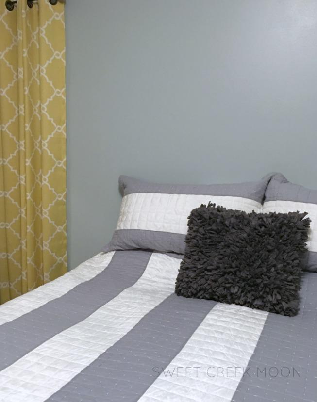 boring bedroom plus one pillow