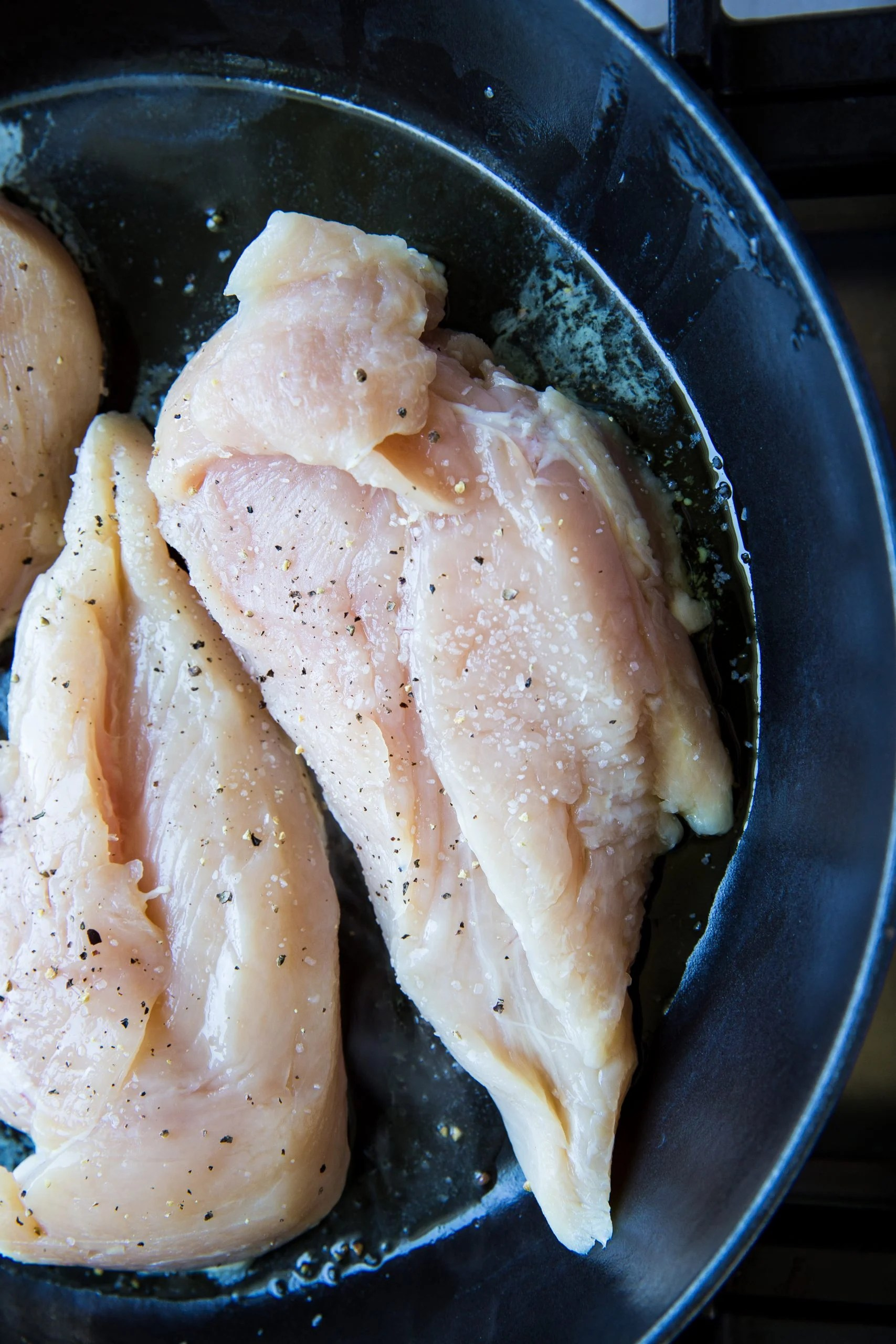 picture of raw chicken in pan